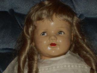 face has the extraordinary glancing blue eyes. Her name is Kristin
