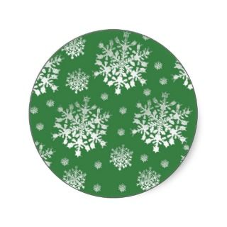 White on Green Snowflake Design Round Stickers