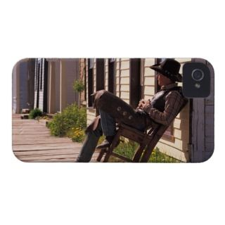 Cowboy in chair on boardwalk in South Park City, iPhone 4 Cover