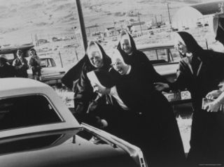 Catholic Nuns Greeting Senator Robert F. Kennedy in Car Premium Photographic Print by Bill Eppridge