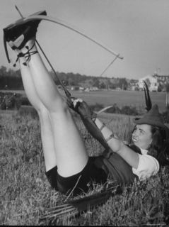 Film Actress Ella Raines Preparing to Use a Bow and Arrow Premium Photographic Print by Walter Sanders