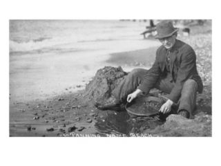 Man Panning Gold on Nome, Alaska Beach in the Early 20th Century Premium Poster