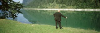 Bald Businessman Playing Golf Bavaria Germany Photographic Print by Panoramic Images