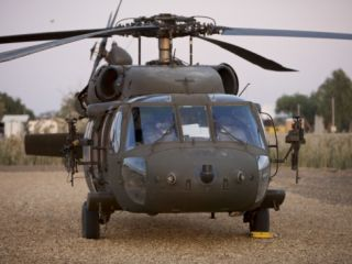 A UH 60L Black Hawk with Twin M240G Machine Guns at the Victory Base Complex in Baghdad, Iraq Photographic Print