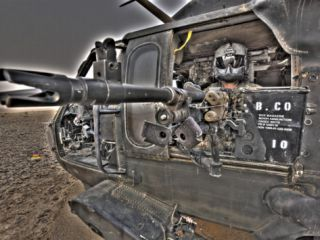 A UH 60 Black Hawk Door Gunner Manning a M240G Medium Machine Gun Photographic Print