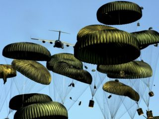 A U.S. Air Force C 17 Globemaster III Airdrops Pallets to Port Au Prince, Haiti Photographic Print by Stocktrek Images