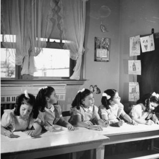 View of the Dionne Quintuplets Working in Class Premium Photographic Print by Hansel Mieth