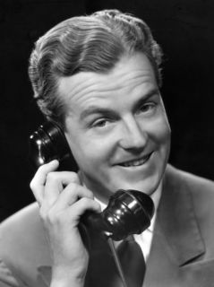 Smiling Executive on Telephone Photographic Print by George Marks