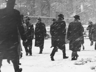People Walking on Street in Snowstorm Photographic Print by George Marks