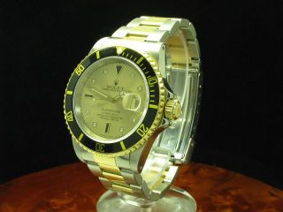 ROLEX SUBMARINER 18kt GOLD / STAHL HERRENUHR SULTAN ZIFFERBLATT / REF