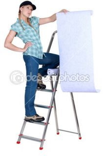 Decorator considering a wallpaper  Foto Stock © photography33