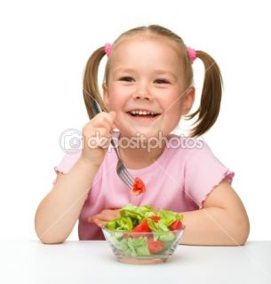Cute little girl eats vegetable salad  Stock Photo © Сергей