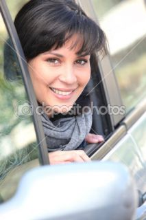 Young woman leaning out of the window of a car  Foto Stock