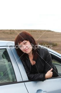 Young brunette looks out the car window  Foto Stock © Юля