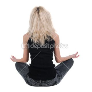 Beautiful businesswoman exercising yoga .rear view.  Stock Photo