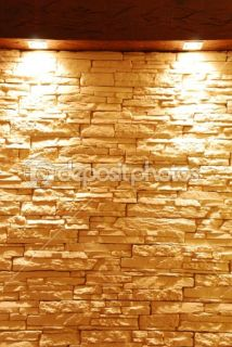 Unshaped stone wall with spot lights  Foto Stock © Luis Santos