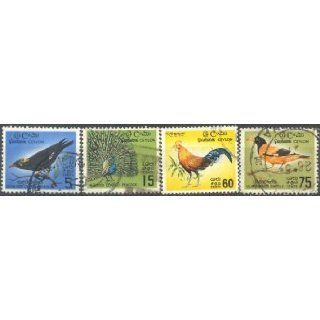 Birds on Postage Stamps: Birds of Ceylon: Jungle Fowl, Hill Myna, Blue